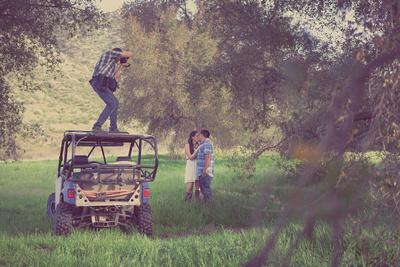 Photographer on Buggy capturing Engagement Photo