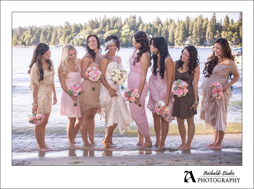 bride and bridesmaids in water